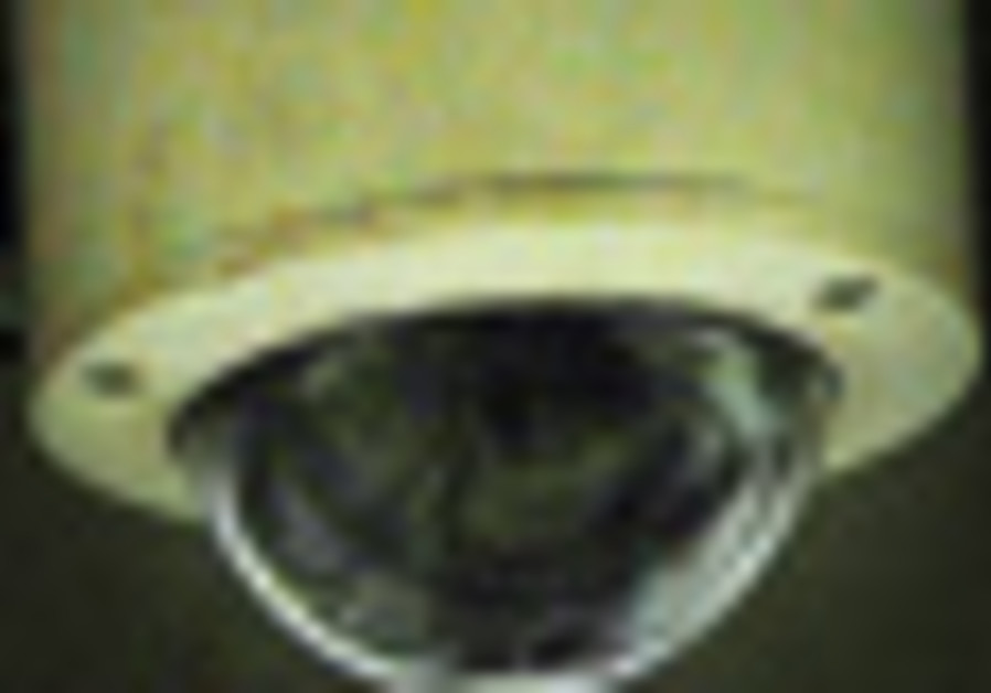 Subway security: Two ceiling-mounted video surveil