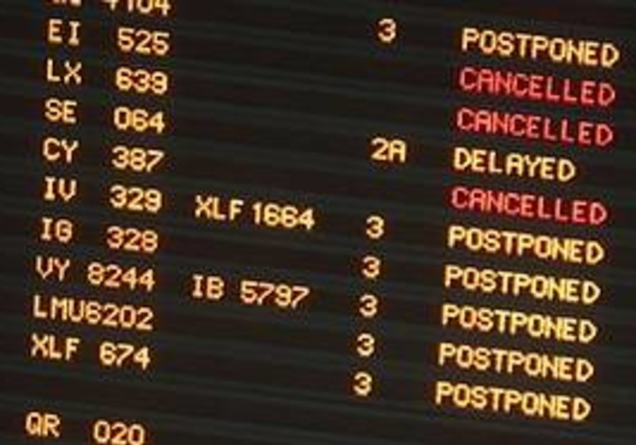 A passenger information board displays some disrup