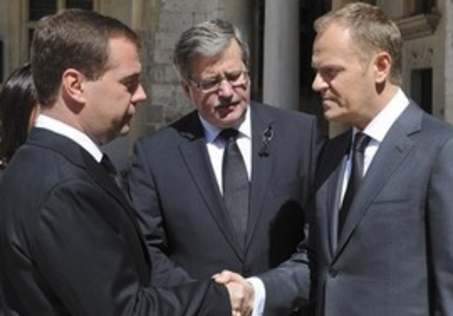 Poland's Prime Minister Donald Tusk, right, and ac