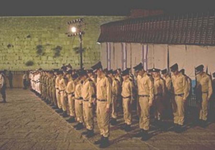 Soldiers observe a minute of silence during a serv