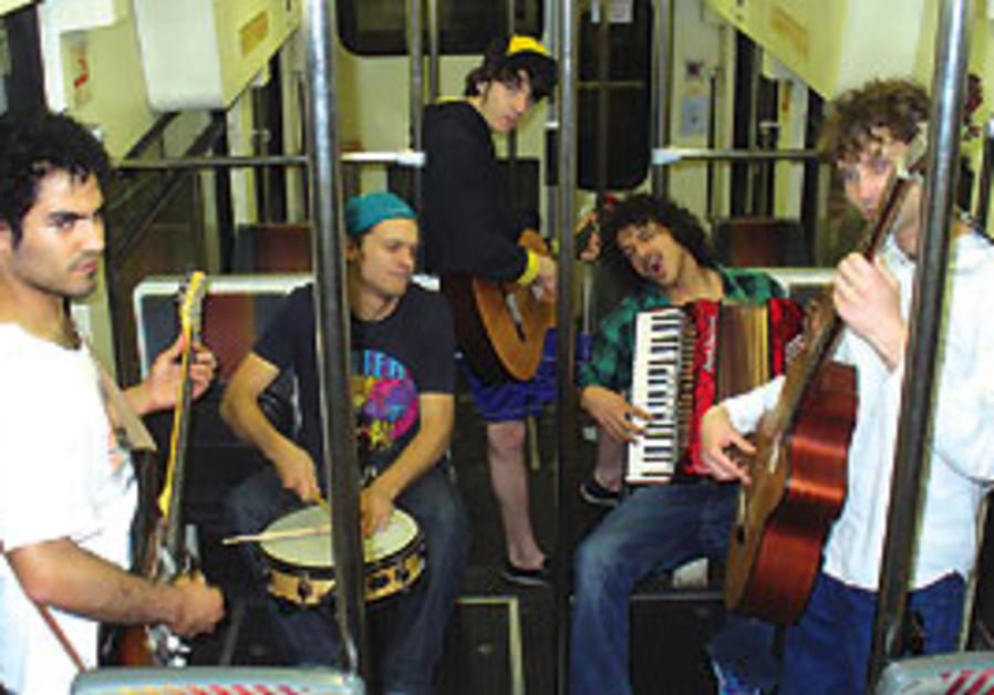 Musicians on the Carmelit train in Haifa