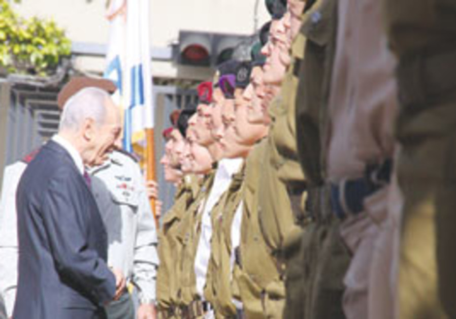 Peres Inspecting soldiers on Independence Day