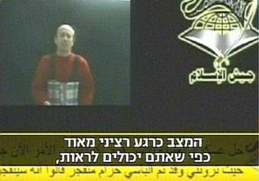 Johnston shown wearing suicide belt
