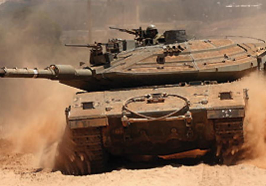 A TANK battles sandy terrain. Maj. Yair and his te