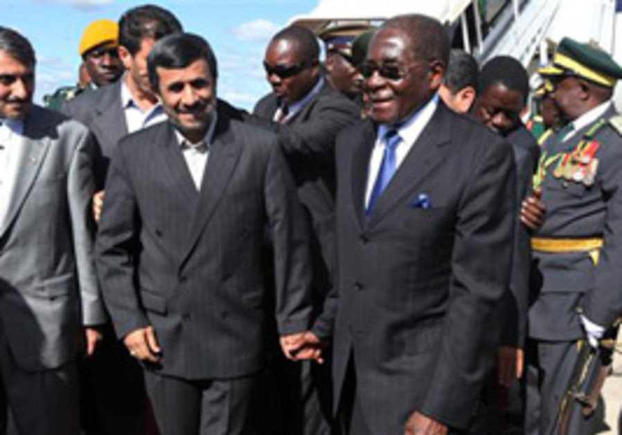 mugabe ahmadinejad hold hands