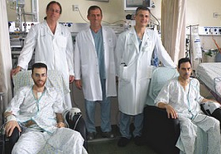 Iluz (left) and Abuhatzeira, with Prof. Dan Aravot