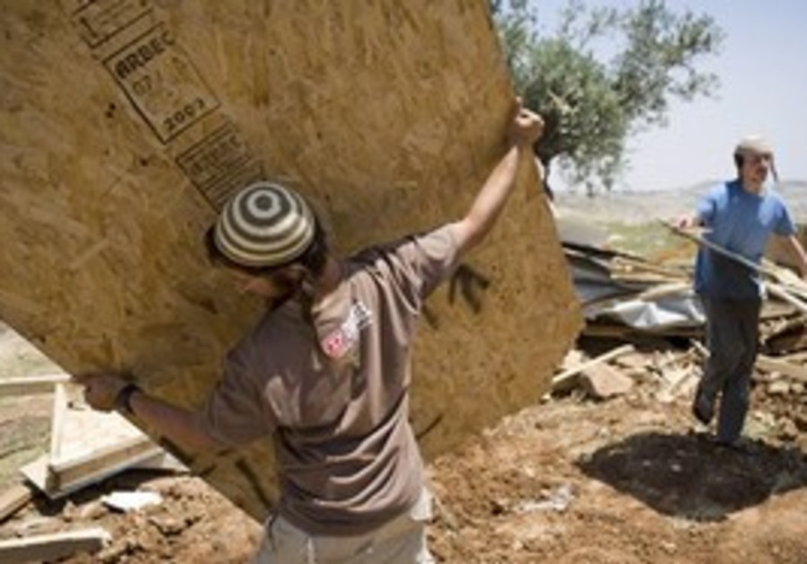 Settlers rebuild the Migron illegal outpost in the