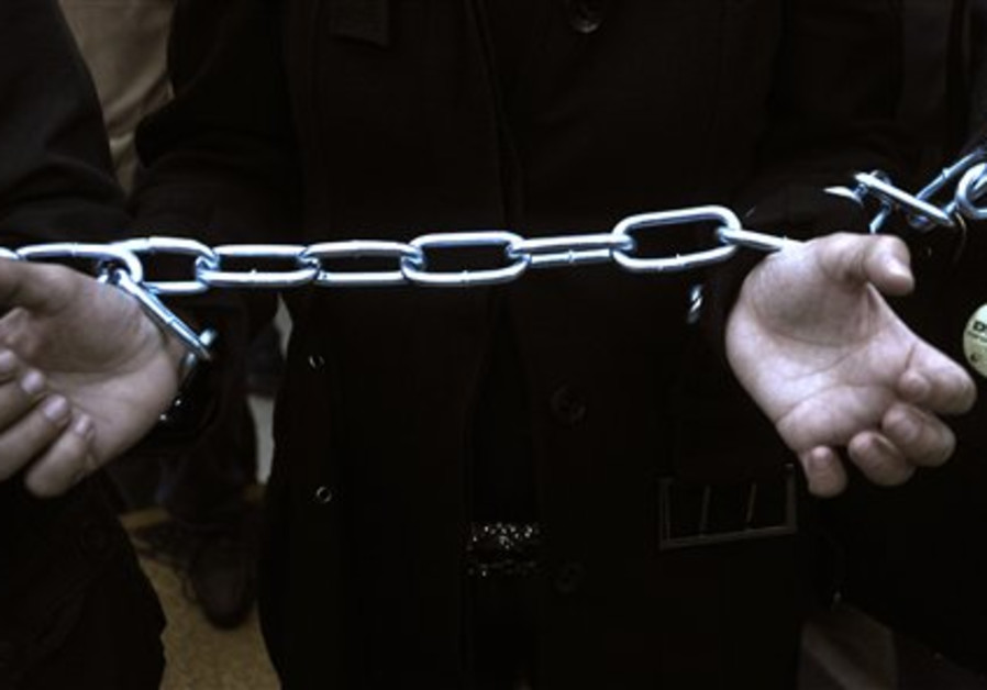An unemployed schoolteacher uses chains during an