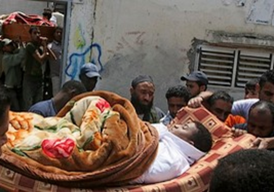 Palestinian mourners carry the bodies of smuggling