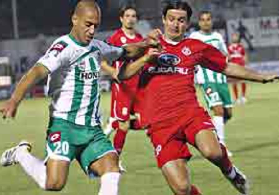 Ben Dayan and Katan challenge for the ball