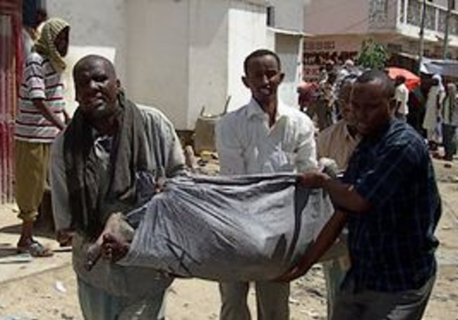 Relatives and friends carry one of the dead, after