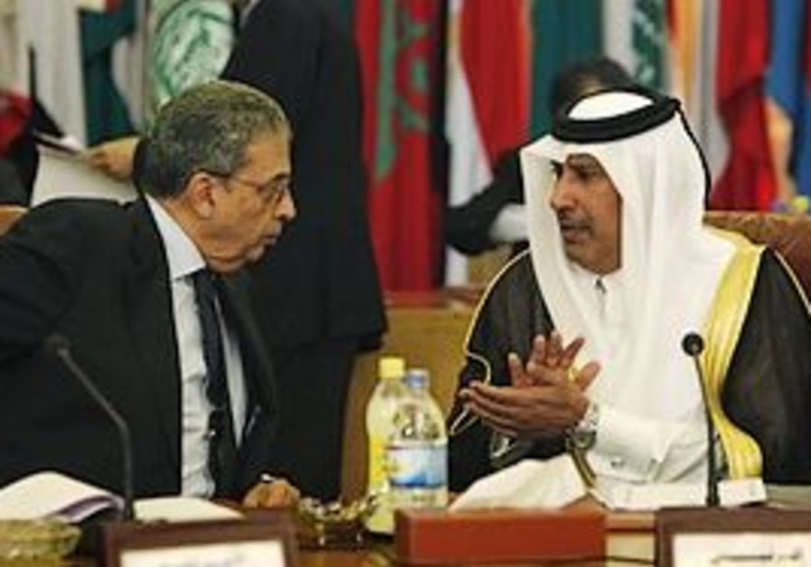 Arab League Secretary General Amr Moussa, left tal
