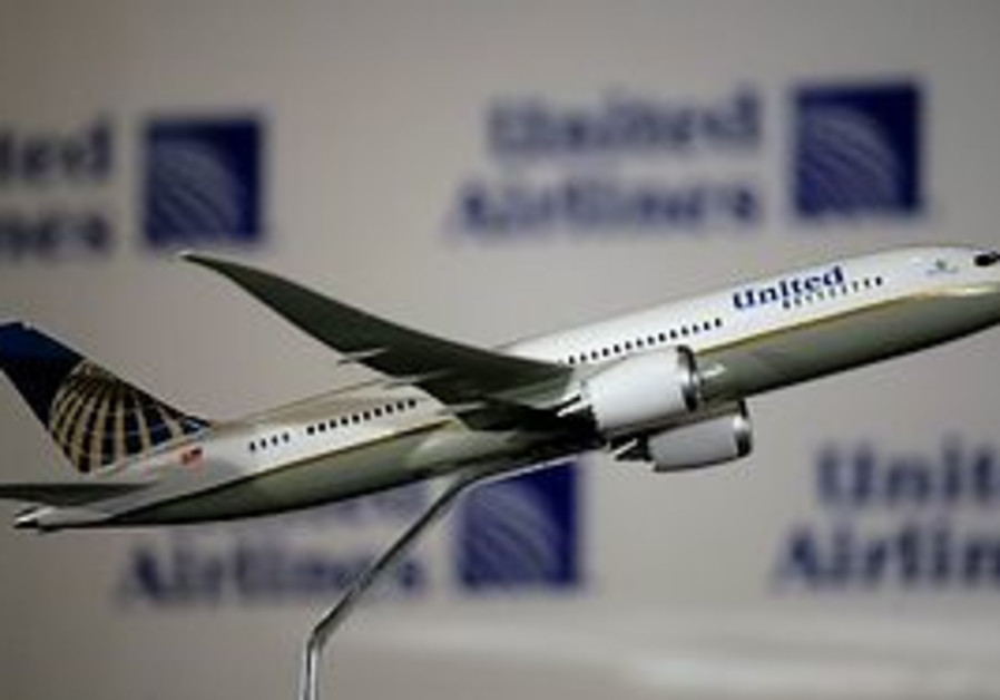 The new logo for United Airlines is shown during a