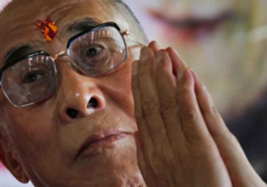 THE DALAI LAMA. 'It remains a striking phenomenon