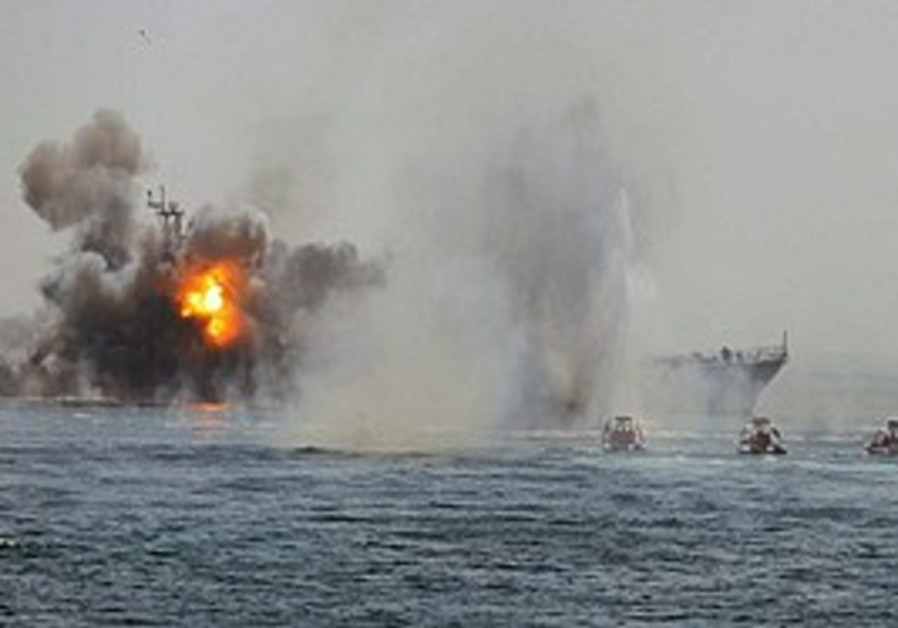 Revolutionary Guard boats attack an abandoned war