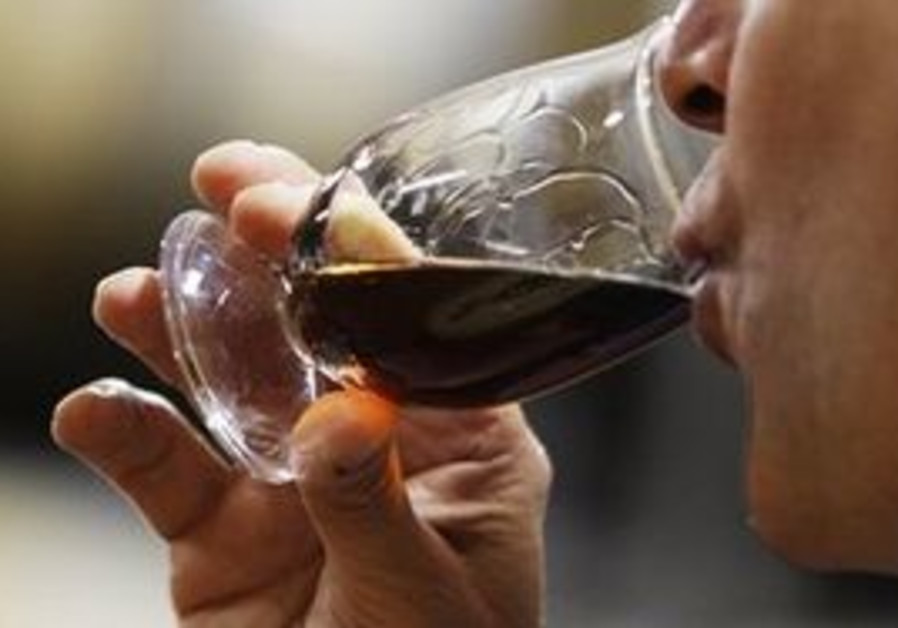 A man drinking liquor.