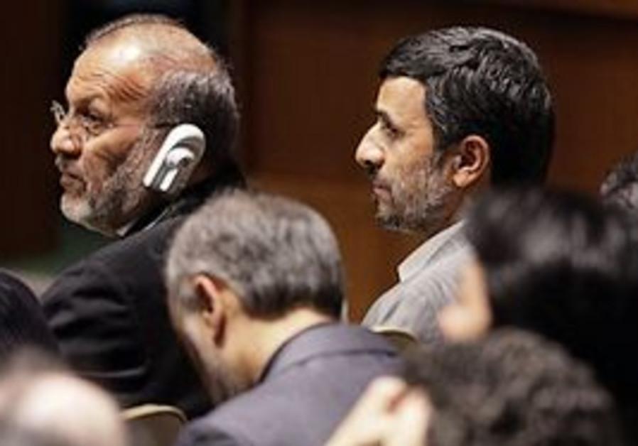 Iranian Foreign Minister Manouchehr Mottaki, left,