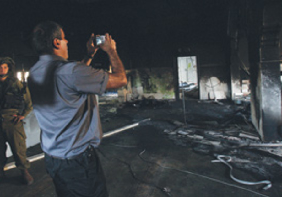 Palestinian and IDF examine mosque fire damage