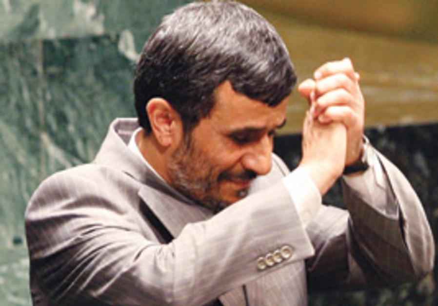 ahmadinejad hand clap