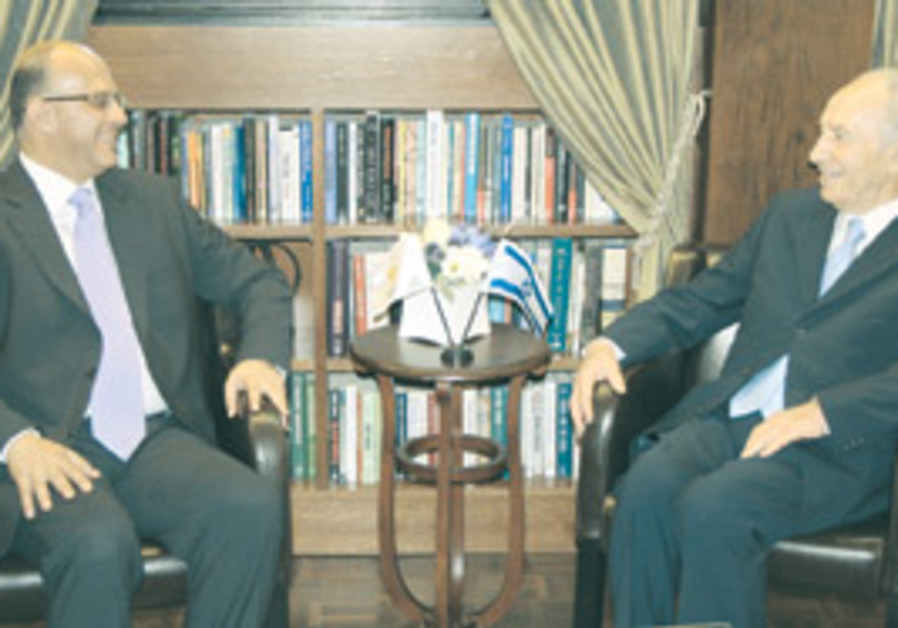 President Peres talks with Marios Garoyian, presid