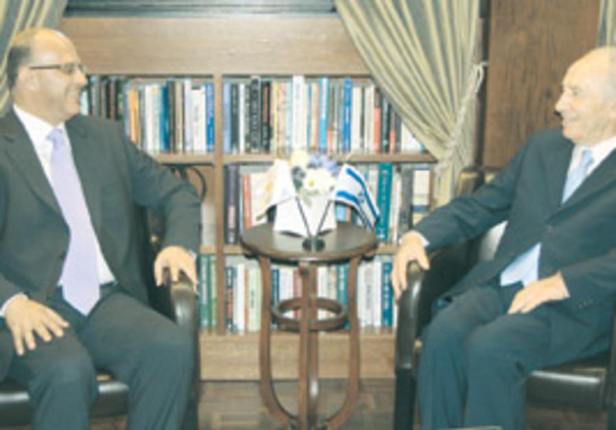 President Peres talks with Marios Garoyian, presid
