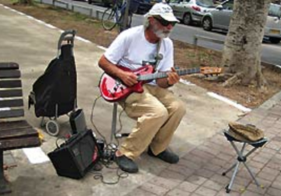Norman Cohen playing in the park off the corner of