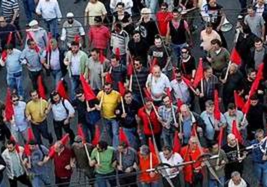 Pro communist protesters march during an anti gove