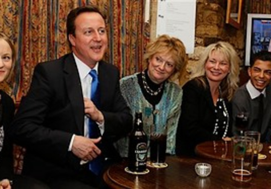 David Cameron visits a pub in his constituency Wit