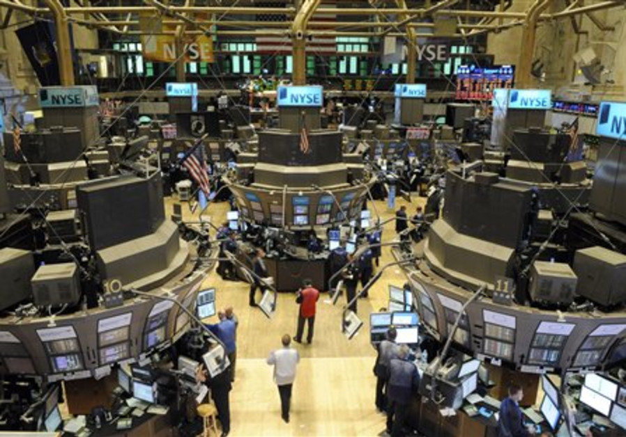 Traders are seen on the floor of the New York Stoc