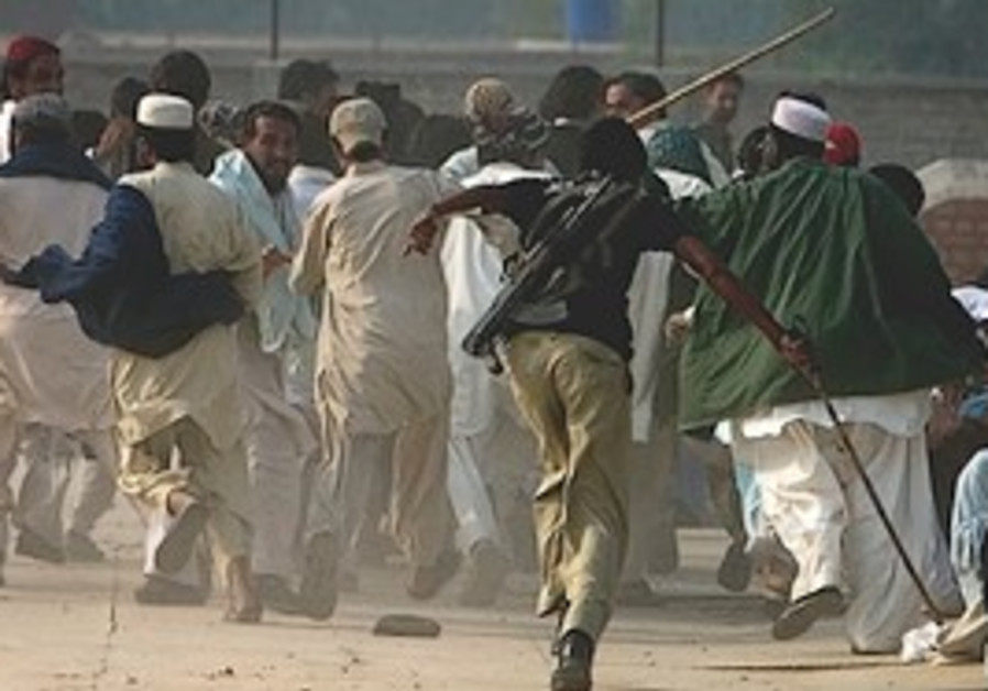 Pakistani police officer chases mob of tribal peop