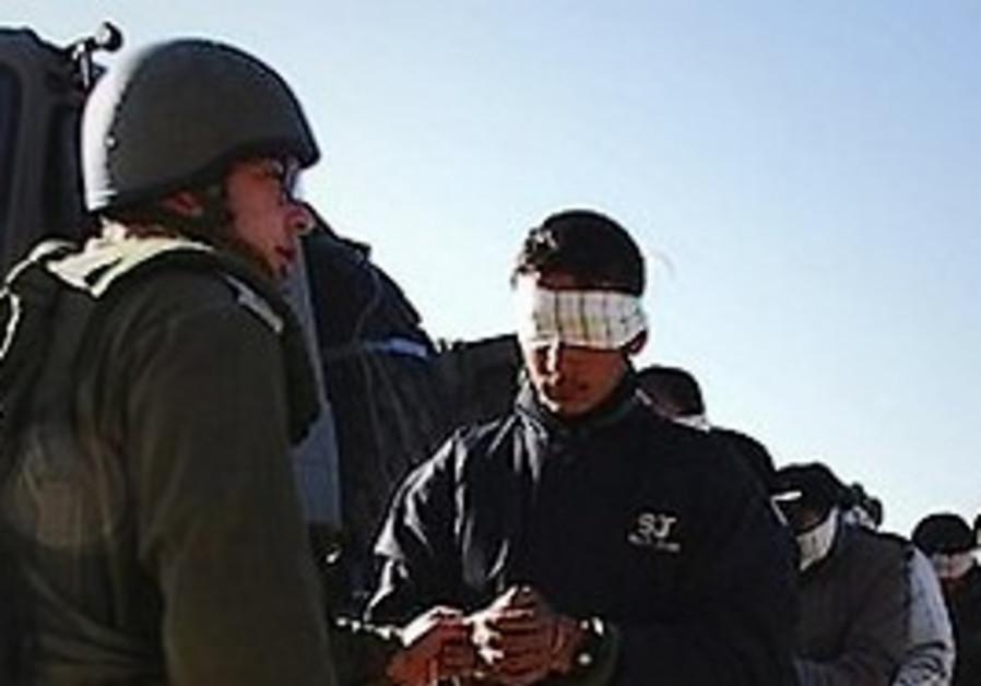 soldier arrests palestinian