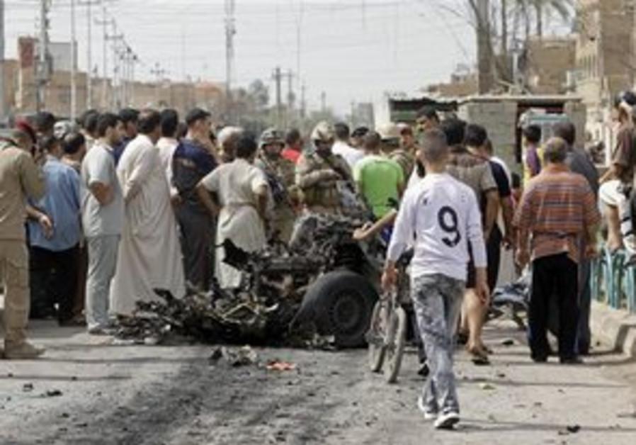 Spectators inspect Baghdad attack site