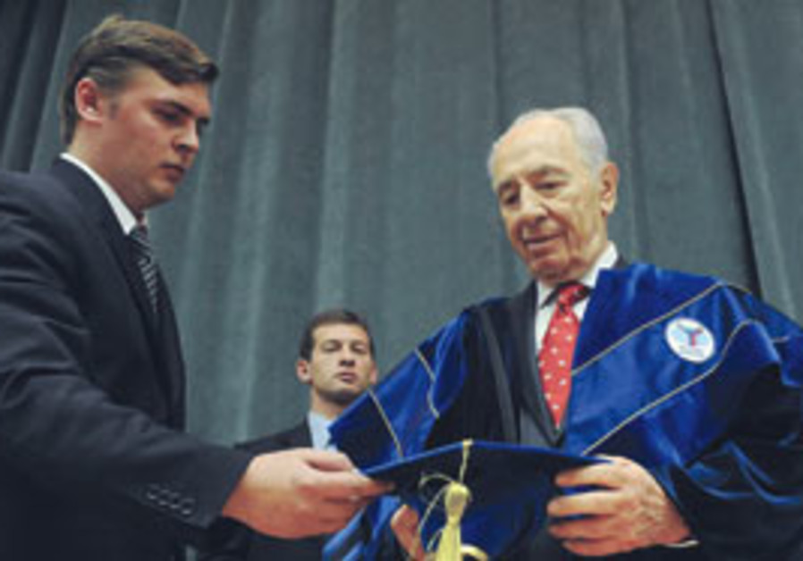 PRESIDENT SHIMON PERES receives an honorary doctor