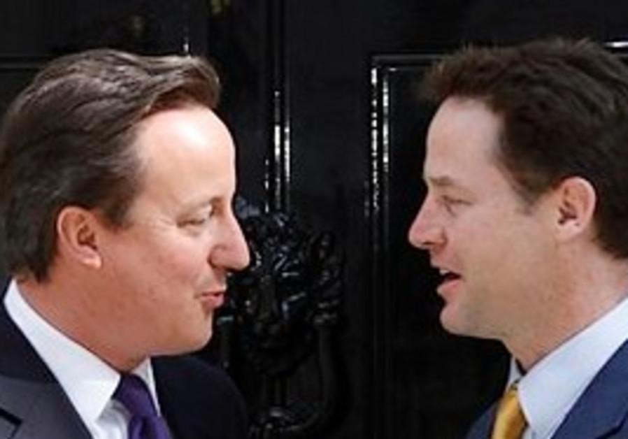 New British Prime Minister David Cameron greets le