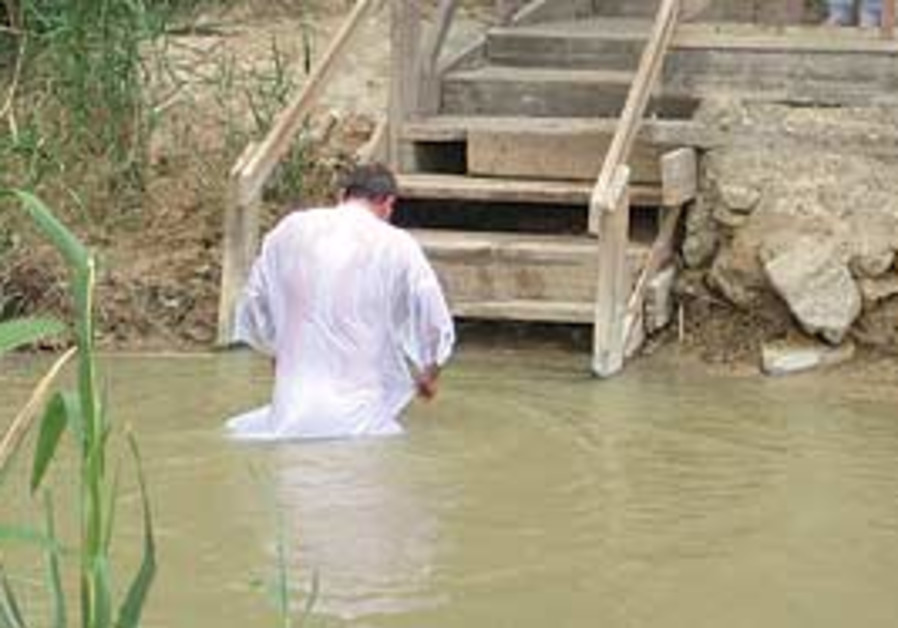 A pilgrim in the Jordan river