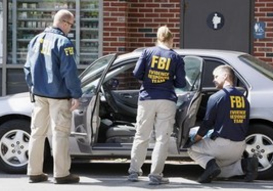 FBI investigators search a car at a service statio