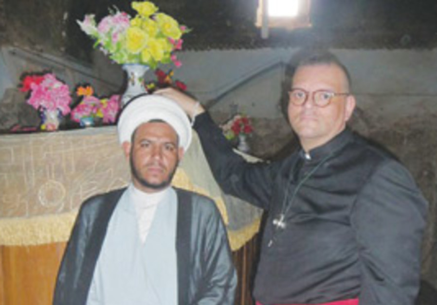Canon Andrew White with a Muslim official at Ezeki