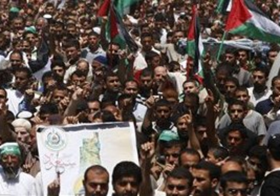 Palestinians wave Palestinian flags during a Nakba