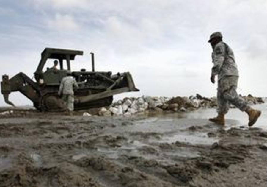 Members of the Louisiana National Guard build a le