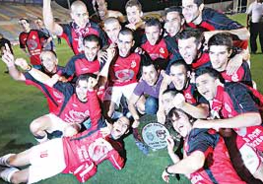 Hapoel TA players celebrate title.