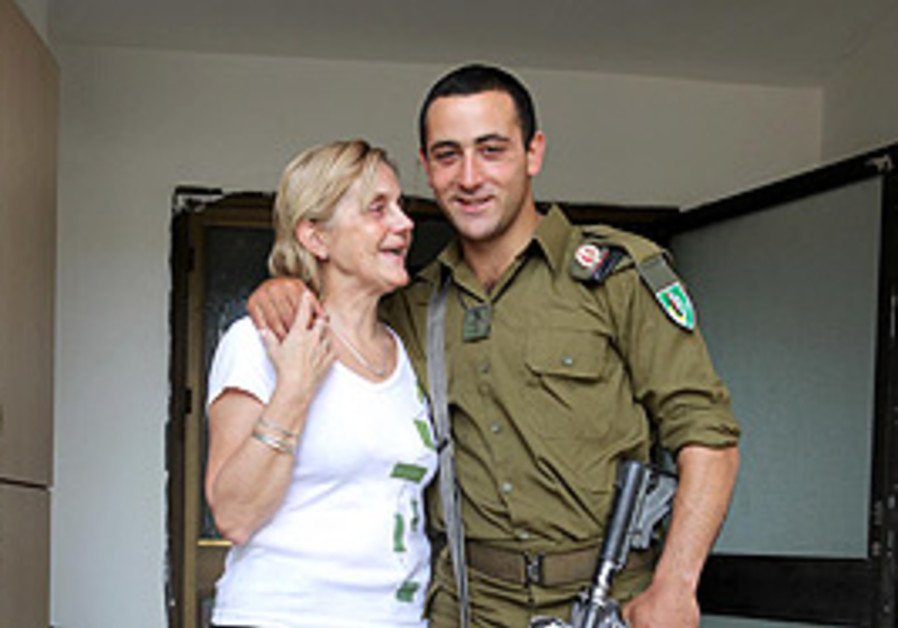 Lone soldier David Musali hugs his mother, who cam