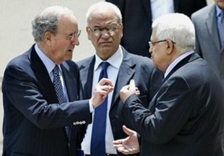 U.S. Middle East envoy George Mitchell, left, talk