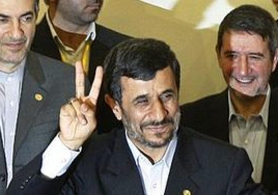 Iranian President Mahmoud Ahmadinejad, flashes a v
