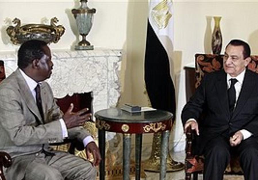 Egyptian President Hosni Mubarak, right, meets wit