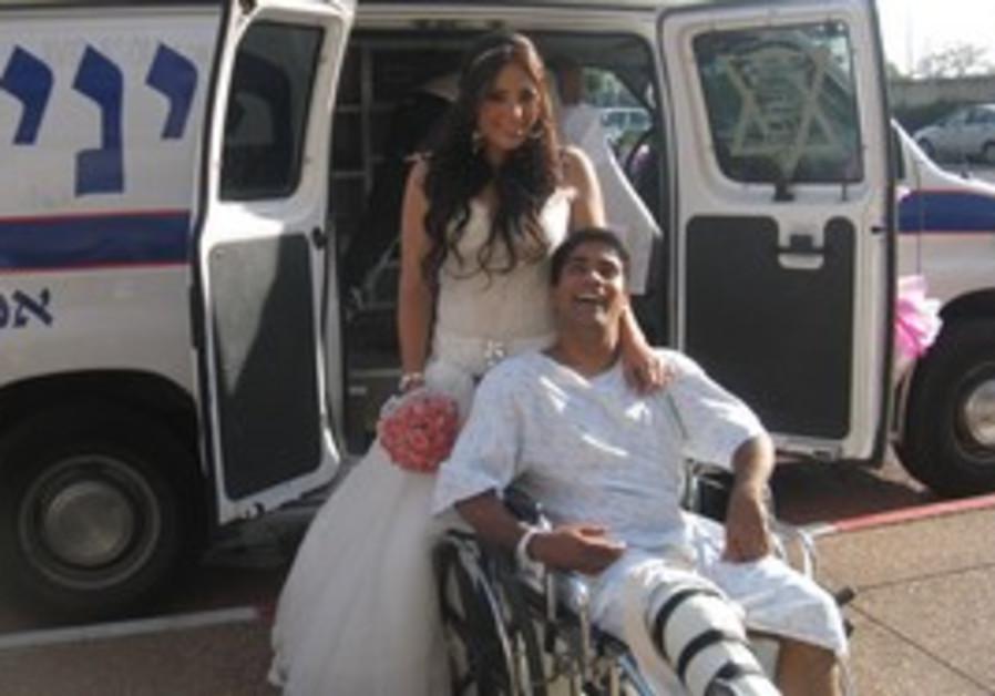 Shlomi Maliniaker and his bride, Mali, outside the