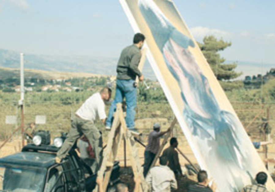 Israeli soldiers (left) watch closely from the oth