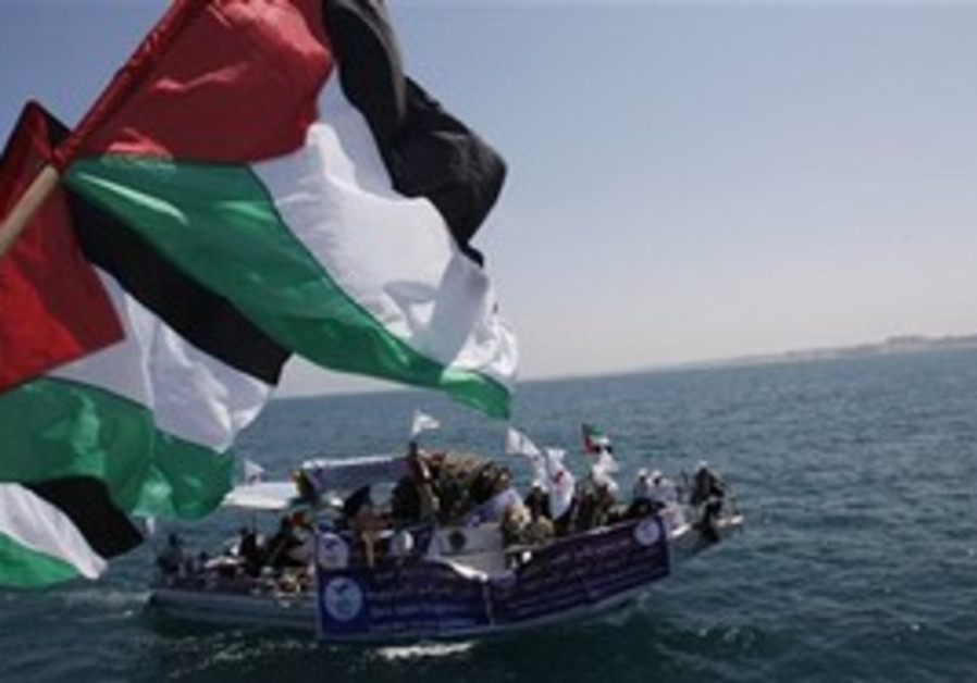 Palestinian flags wave in Gaza port, foreground, a