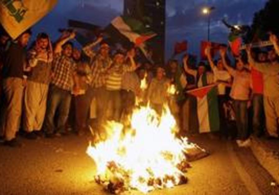 Protesters burn a representation of former prime m