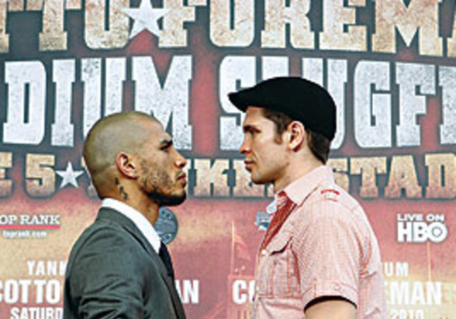 MIGUEL COTTO (left) and Yuri Foreman pose together