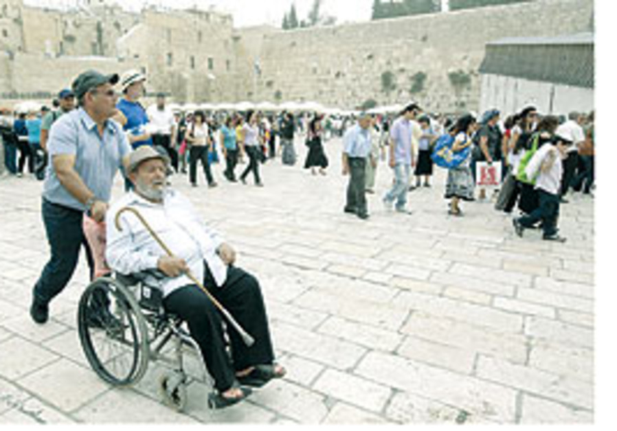 Disabled tourist at Western Wall